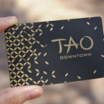 metal business card with black finish and gold